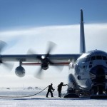 Russian Passengers Get out of the Frozen Plane to Push It
