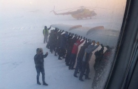passengers push airplane